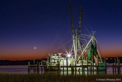 Dusk at Crosby's Seafood by Instagram user (and dunes agent) @donniewhitaker